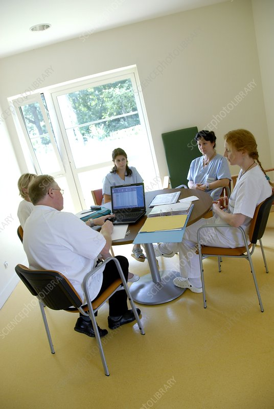 Healthcare workers conduct a meeting