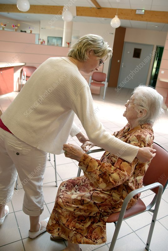 Alzheimer's patient is assisted to walk