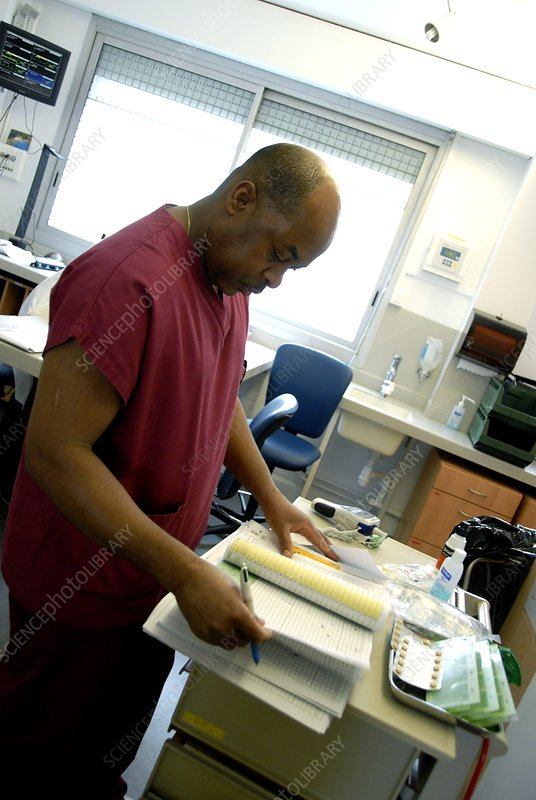 Male nurse at a workstation