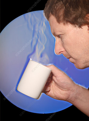 Schlieren Image of Man Drinking Hot Coffe