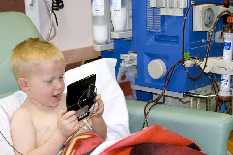 Boy undergoing kidney dialysis