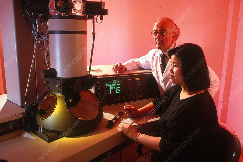 Student Using Electron Microscope