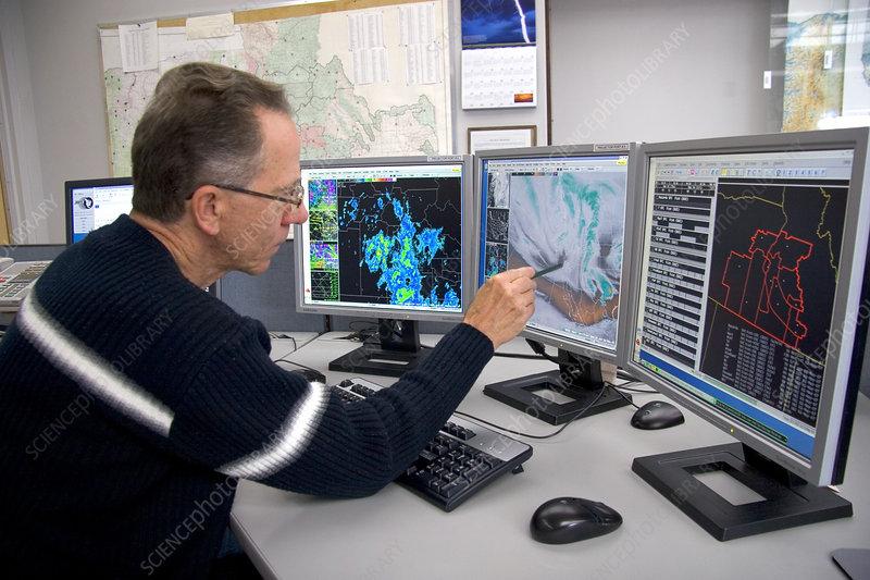 Meteorologist Evaluating Weather Maps