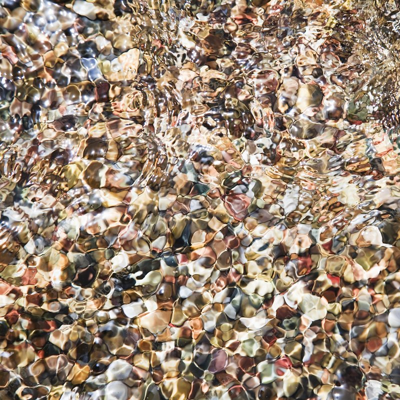 Optically distorted view of sea pebbles