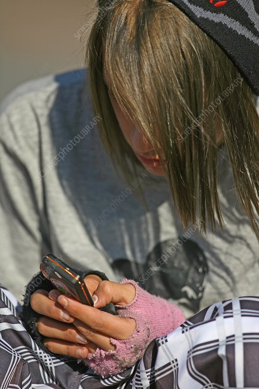 Teenager using a mobile phone