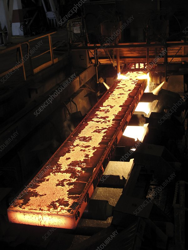 Molten steel bars being cut