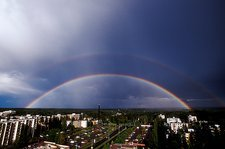Double rainbow over a town