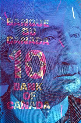 Canadian banknote in UV light