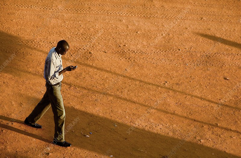 Man using a mobile phone, Uganda