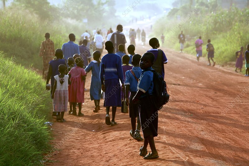 Children walking along a road, Uganda
