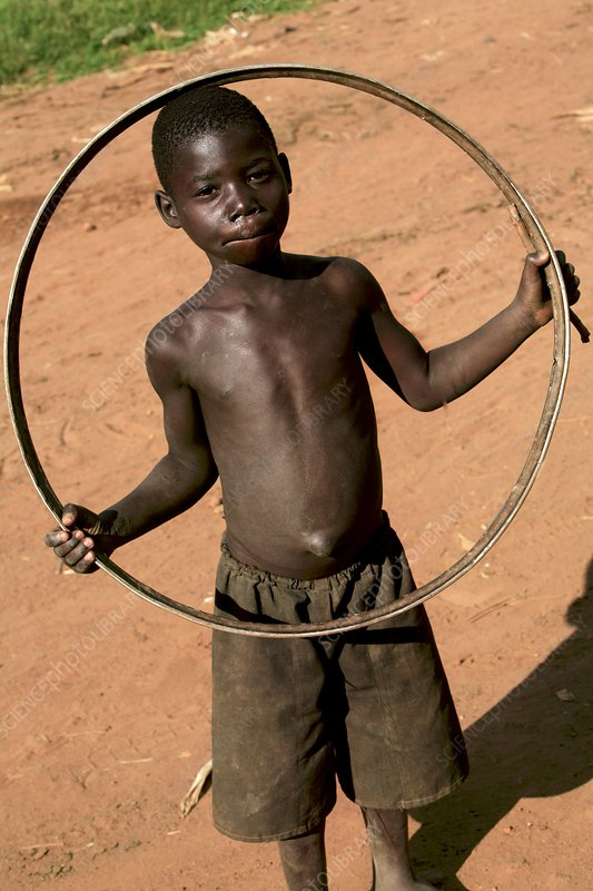 Child playing with a hoop, Uganda