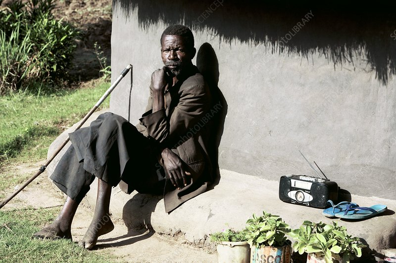 Man sitting outside a hut, Uganda