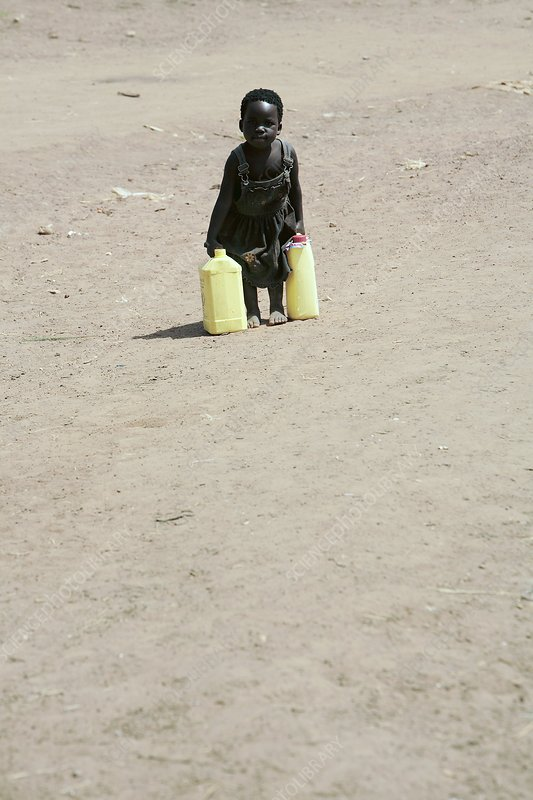 Young child carrying water, Uganda