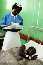 Hospital nurse and patient, Uganda
