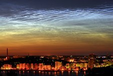 Noctilucent cloud over a city