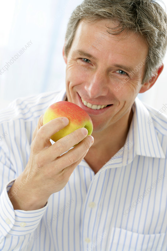 Man eating fruit