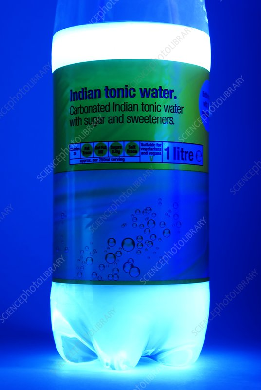 Tonic water bottle in UV light