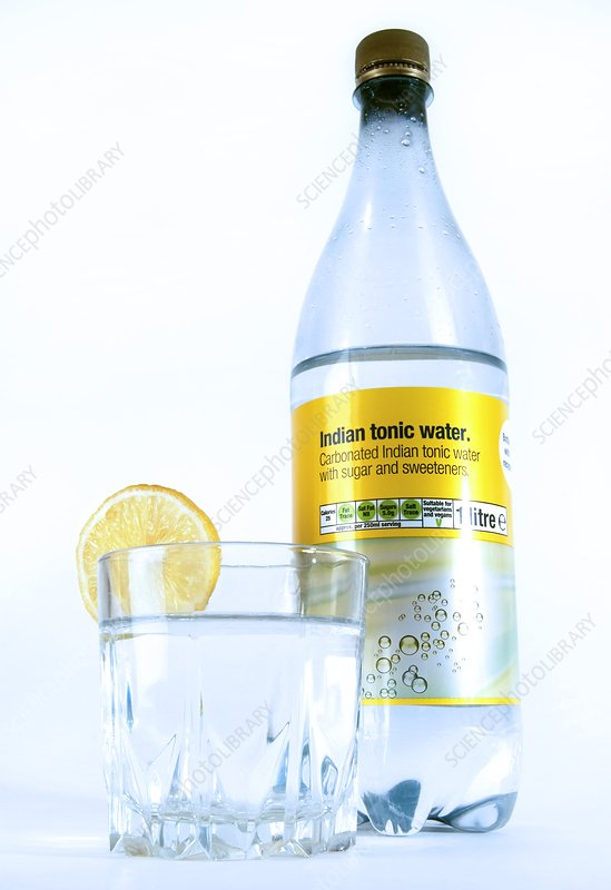 Tonic water bottle and glass