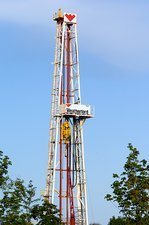 An oil-rig drilling derrick