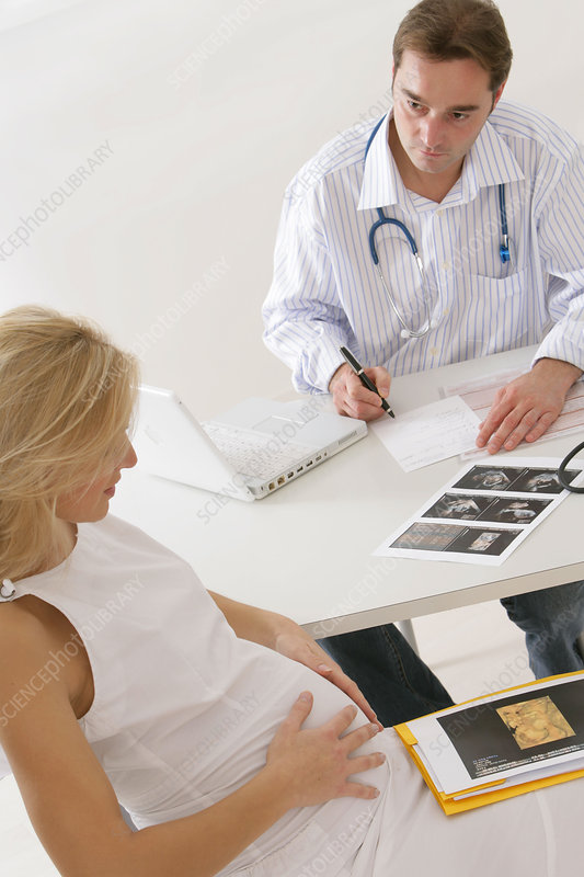 Pregnant woman in consultation