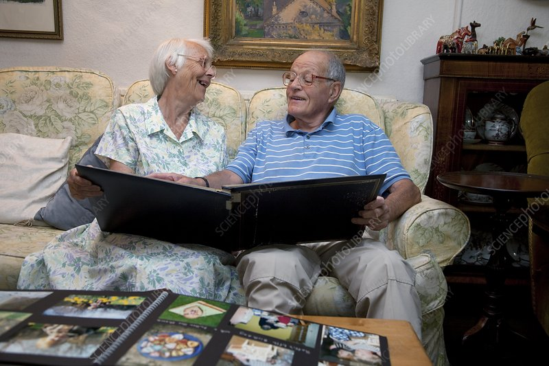 Elderly couple looking at family photos