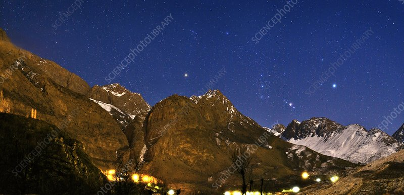 Winter stars above mountains