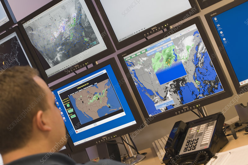 Meteorologist studying weather patterns