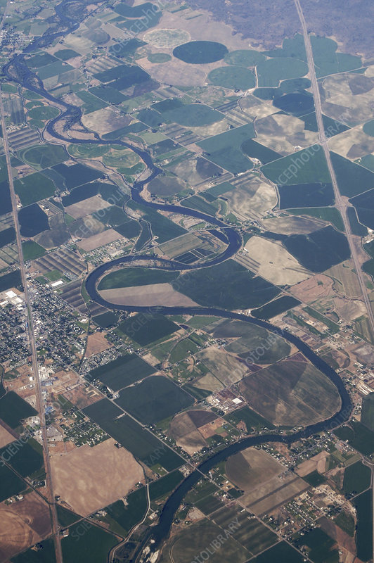 Meandering river through farm land