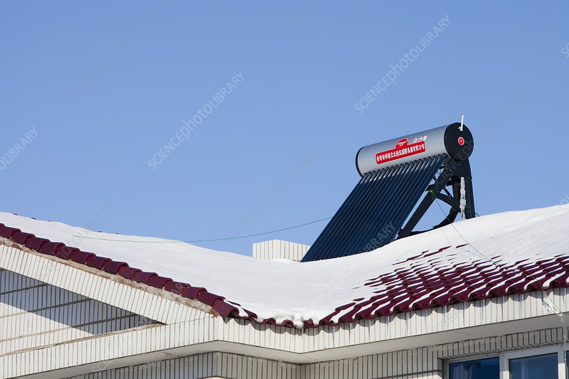 Solar water heater on a Chinese roof