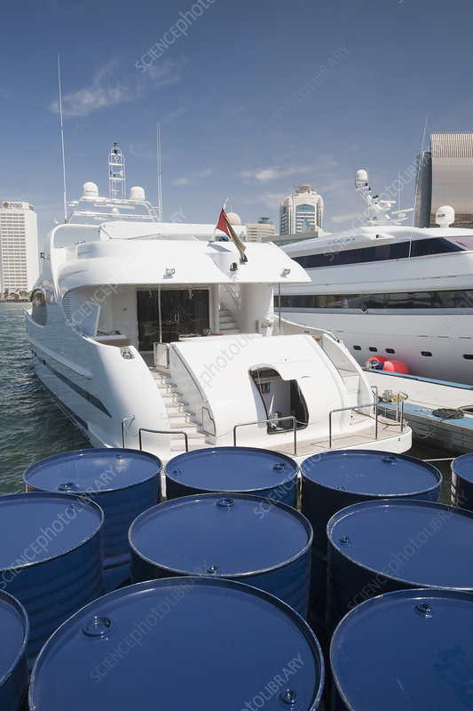 Luxury yachts and oil barrels in Dubai