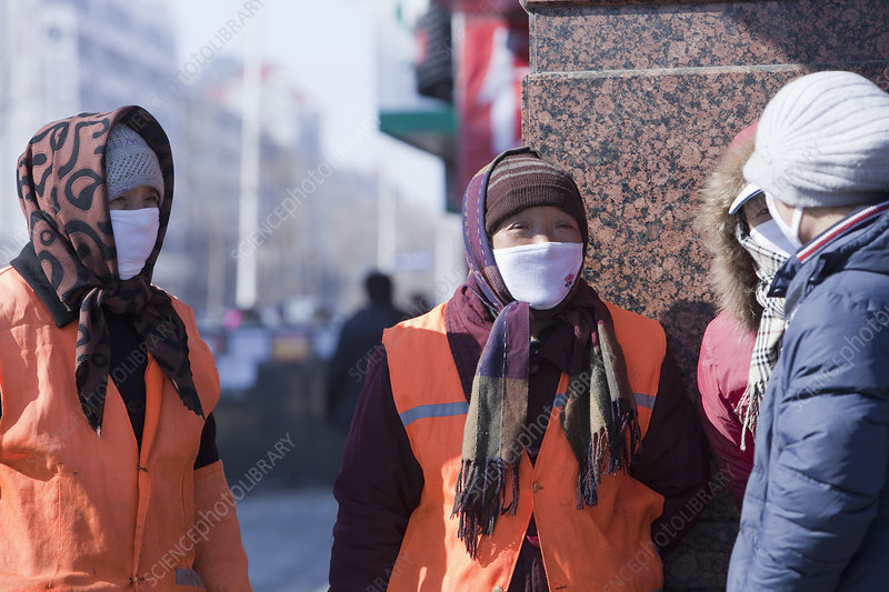 Workers wearing face masks for protection