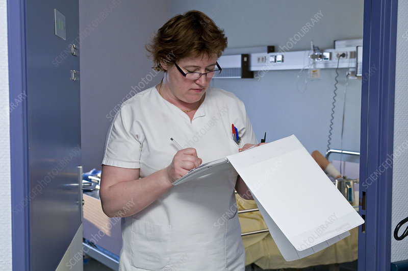 Nurse with patient's record