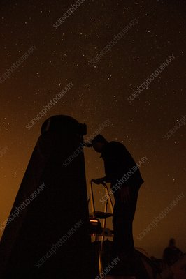 Observer using a Dobsonian telescope