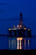 Oil drilling rig at night, North Sea
