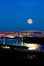 Moon over Vancouver, time-exposure image
