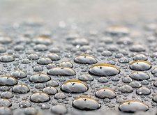 Water drops on a rubber surface