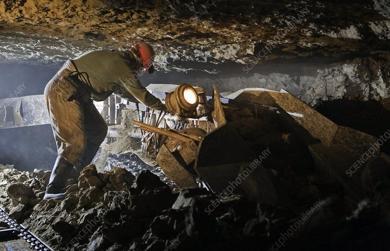 Slate mining. Worker operating an extract