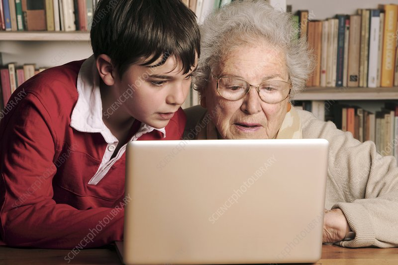 Elderly lady learning to use a laptop