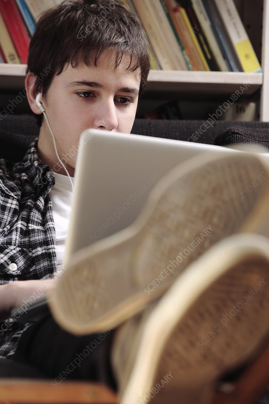 Teenager using a laptop computer
