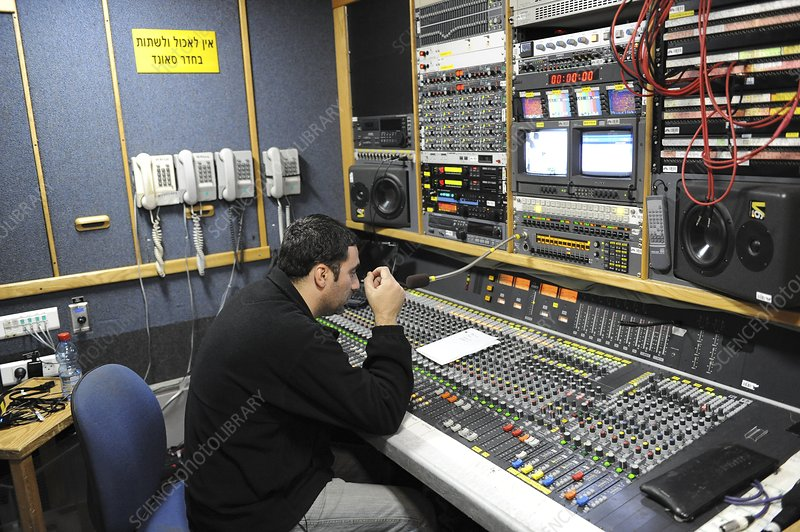 Sound engineer in a control room