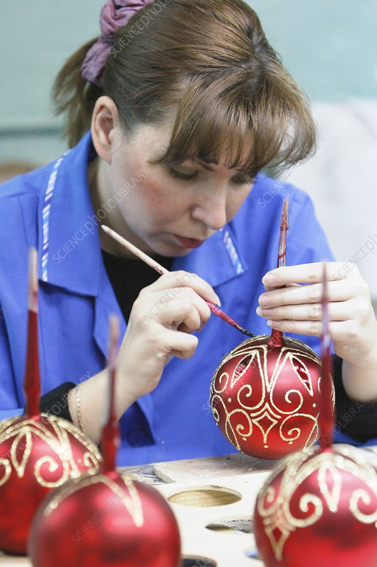 Decorating a Christmas tree ornament