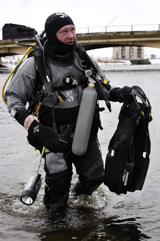 Diver coming out of a river