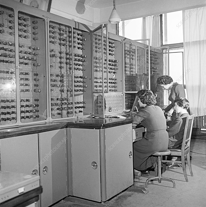 Students working on a computer in 1959