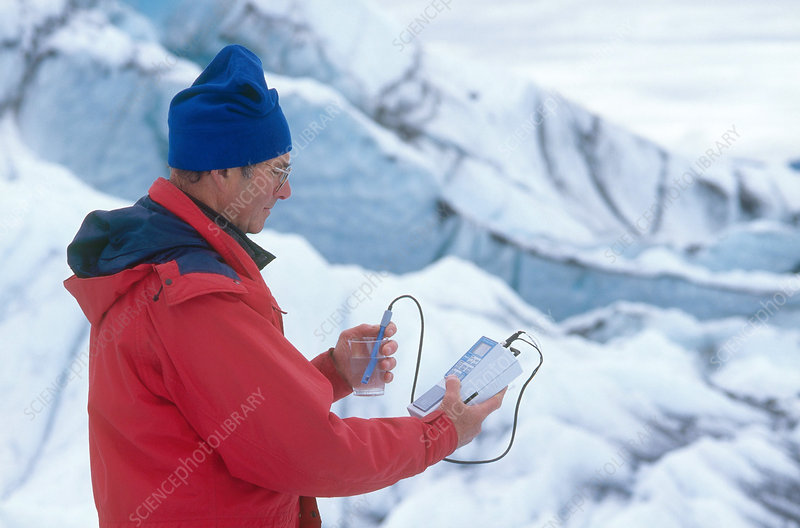 Scientist Measuring pH of Glacial Water