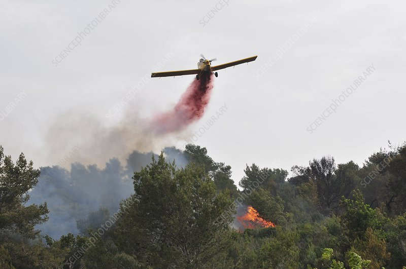 Aircraft drops fire retardant
