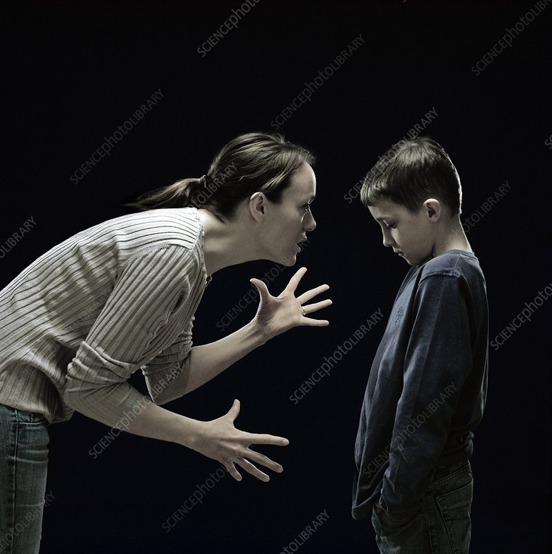 Mother telling off her son