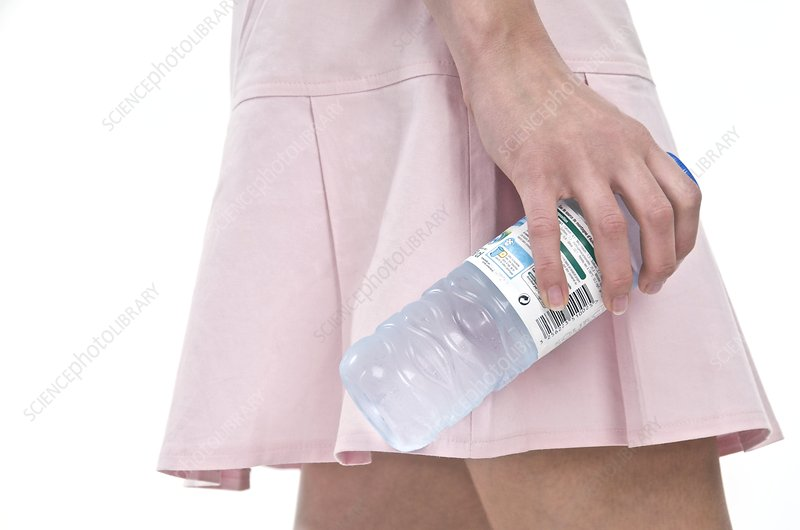 Woman holding a bottle of water