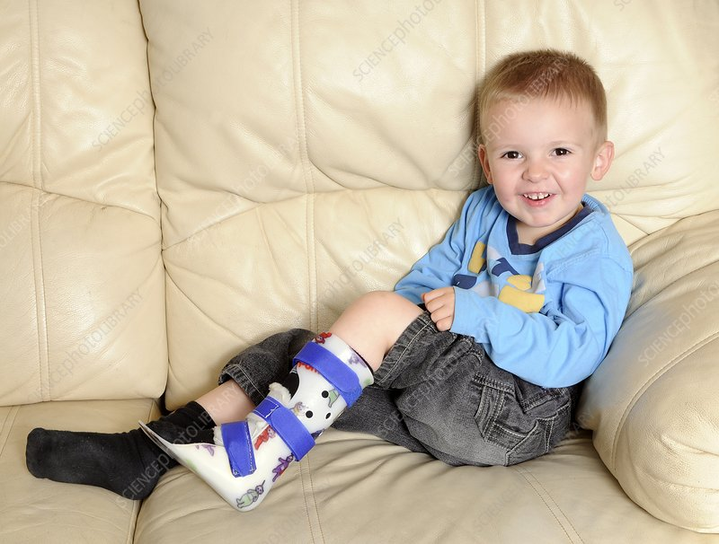 Boy with lower leg brace