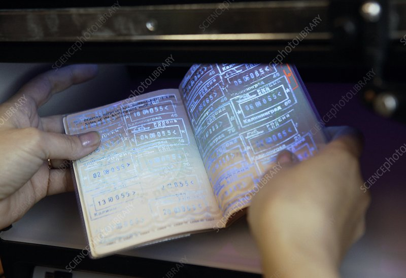 Checking a passport with UV light