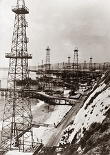 Beach-side oil wells, historical image